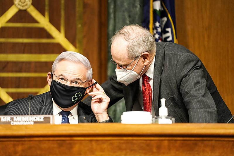 US Senate Foreign Relations Committee Chairman Bob Menendez, left, listens to US Senator Jim Risch prior to a confirmation hearing on March 23. Photo: AFP