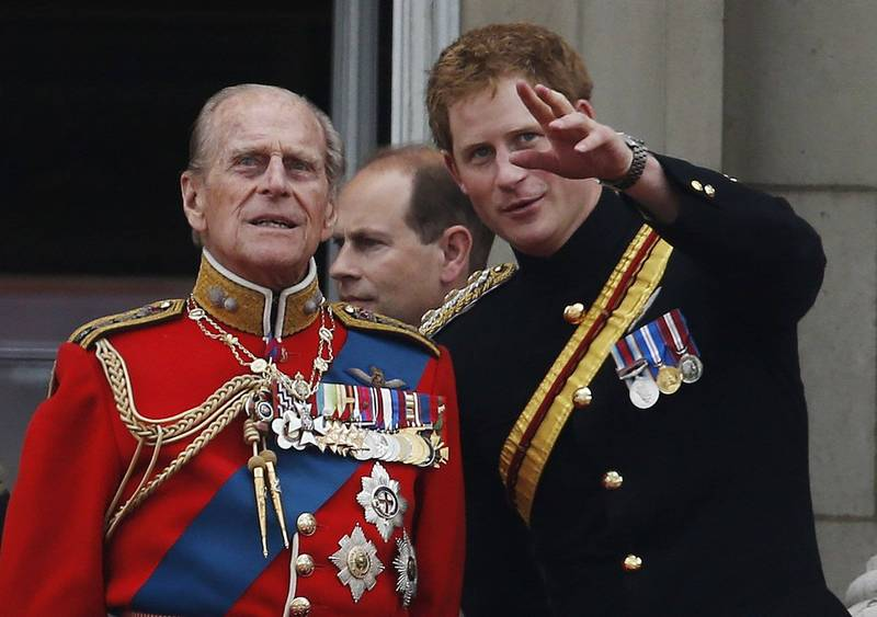 Prince Harry (right) will return to England to attend the funeral of Prince Phillip.  (Associated Press)