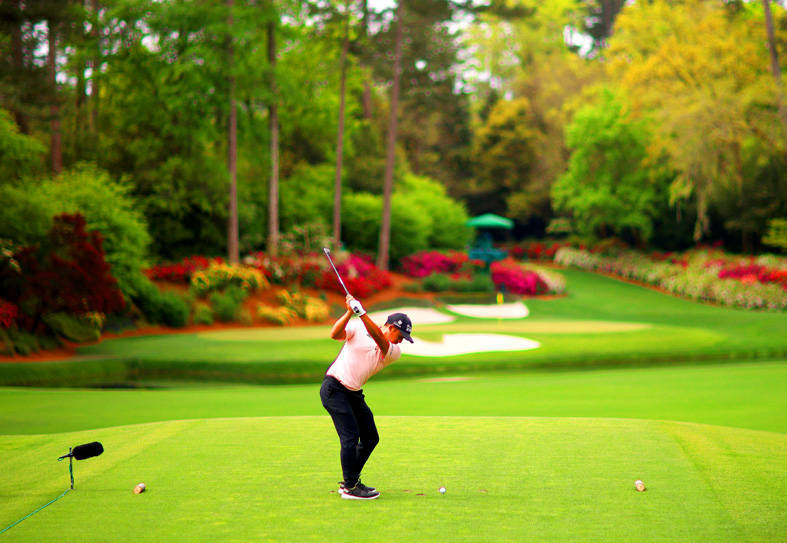 Taiwanese professional golfer C.T. Pan tees off at the Masters tournament in Augusta, Georgia, on Friday. Photo: AFP