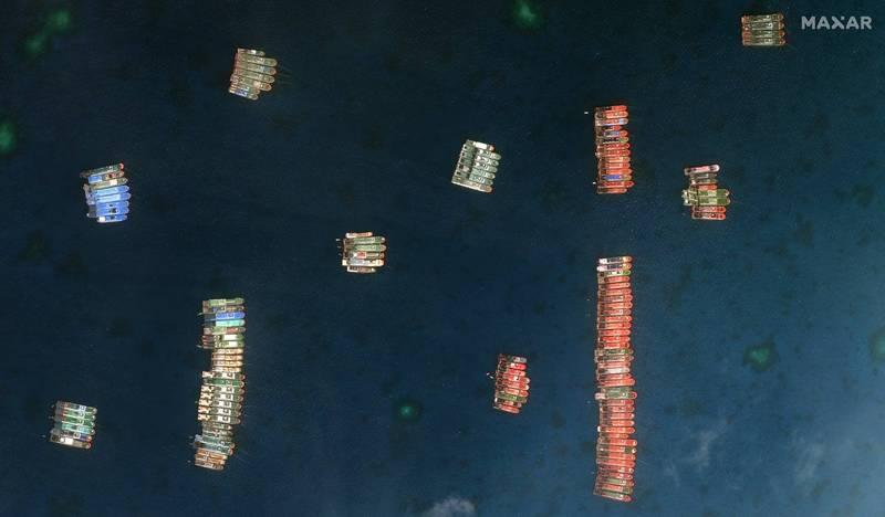 南沙群島當中的牛軛礁附近3月出現數百艘中國船隻,近期雖然分散到其他島嶼附近,但仍有9艘停留,菲律賓外交部昨天罕見召見中國駐菲大使黃溪連,當面質問關於中國船隻在南海爭議島礁附近「非法停留」一事。(歐新社)