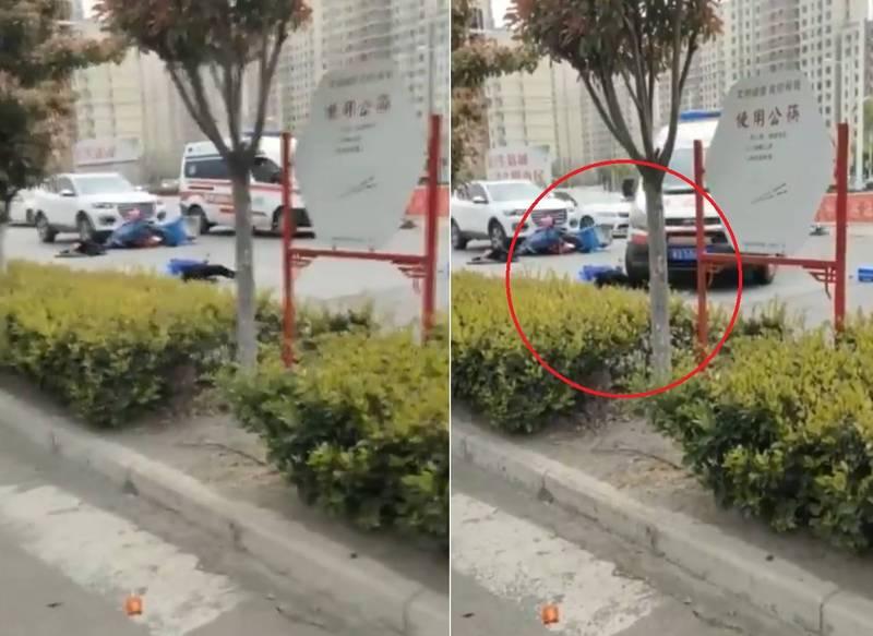 外送員發生交通事故,倒在地上無法起身,救護車到場後,竟直接開到外送員身前,輾過他的左腿。(擷取自微博)