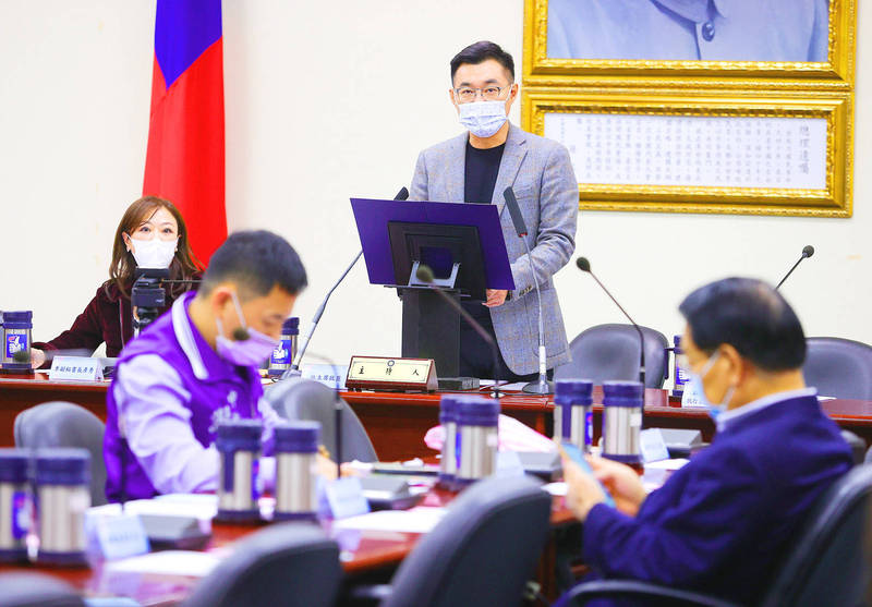 Chinese Nationalist Party (KMT) Chairman Johnny Chiang, standing, speaks about Japan's decision to release processed wastewater from the Fukushima Dai-ichi nuclear power plant at a meeting at the party's headquarters in Taipei yesterday. Photo: CNA