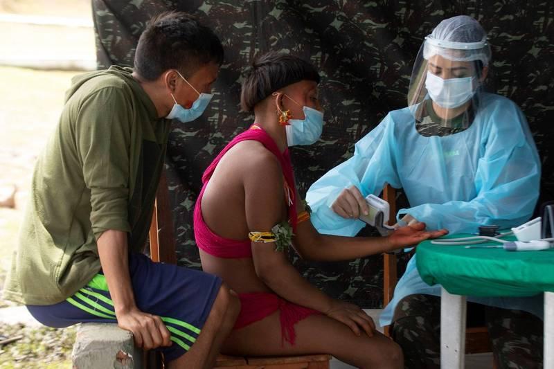 亞諾馬米(Yanomami)是巴西一處偏遠原住民部落,多年來一直遭非法礦工侵擾,帶來武漢肺炎及其他致命疾病。(歐新社)