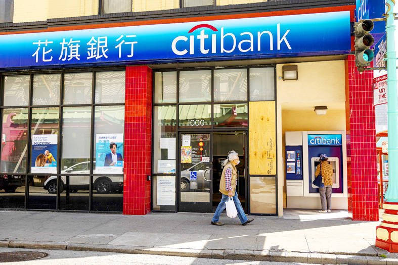 A man passes a Citibank bank branch in San Francisco on Tuesday. Photo: Bloomberg