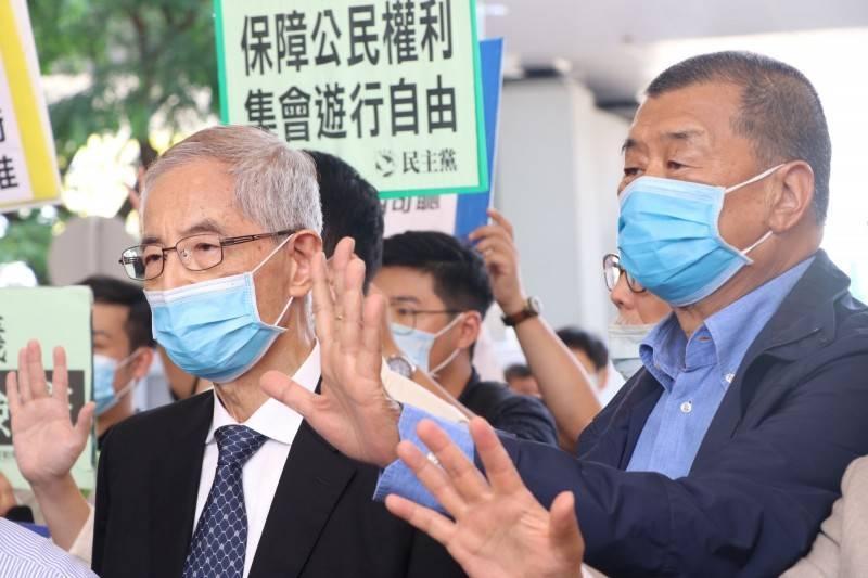 香港民主黨創黨主席李柱銘(左)、壹傳媒創辦人黎智英(右)。(路透)