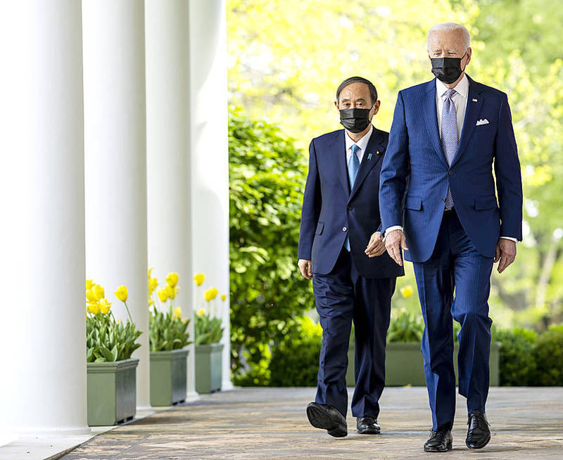 US President Joe Biden, right, and Japanese Prime Minister Yoshihide Suga arrive for a joint news conference at the White House in Washington on Friday. Photo: EPA-EFE