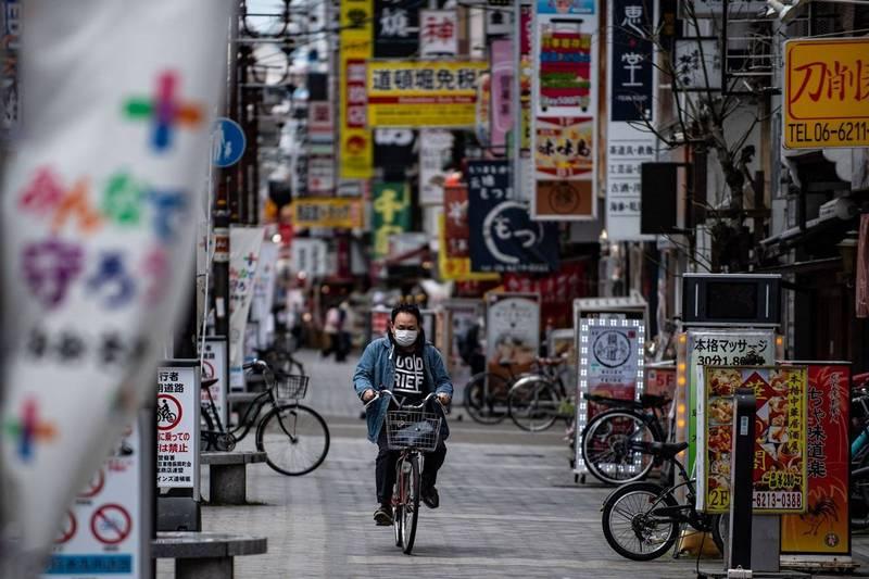 日本16日新增4532例確診、46例死亡,為連續第3日單日新增破4000例記錄。圖為大阪街景,示意圖。(法新社)