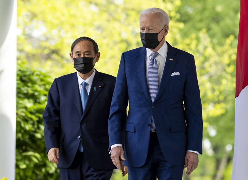 美國總統拜登(Joe Biden)今天在華府與到訪的日本首相菅義偉舉行峰會,兩國領袖誓言堅定聯手抗衡中國,並加強因應氣候變遷及5G通訊方面等領域合作。(歐新社)