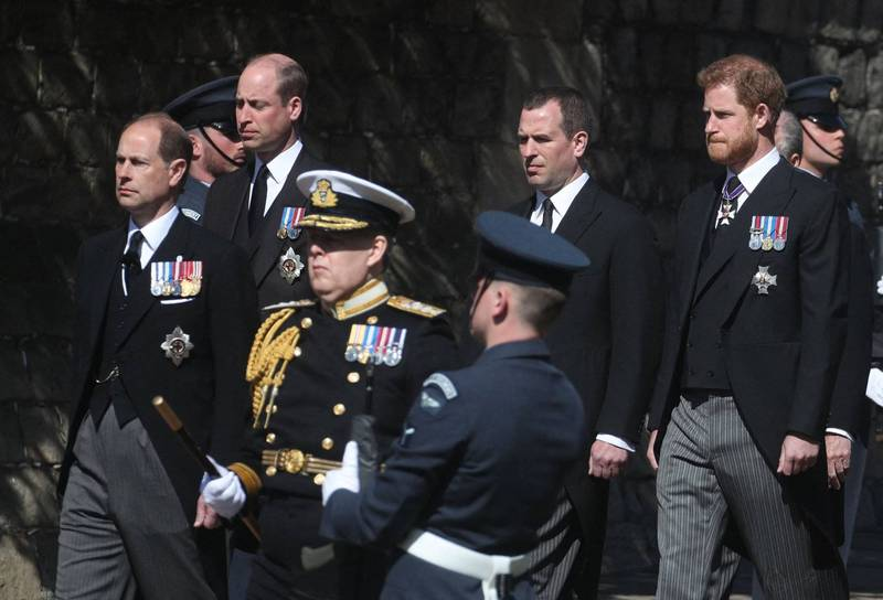 William and Harry are separated by Princess Anne's eldest son and cousin Phillips.  (AFP)