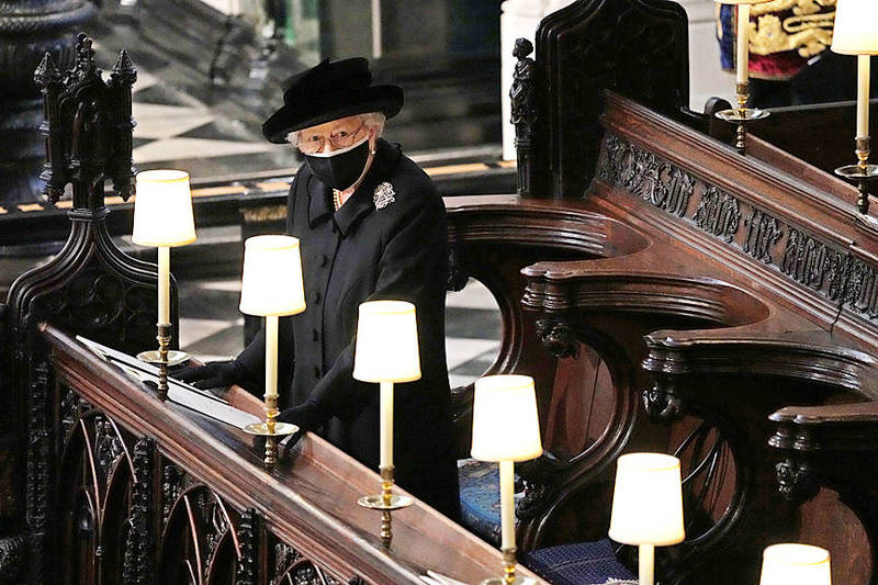 Britain's Queen Elizabeth II stands during the funeral of her husband, Prince Philip, at St George's Chapel, in Windsor, England, on Saturday. Photo: Reuters