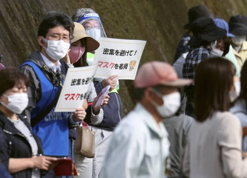 日本武肺疫情仍未趨緩,官方加速執行疫苗接種。(路透)