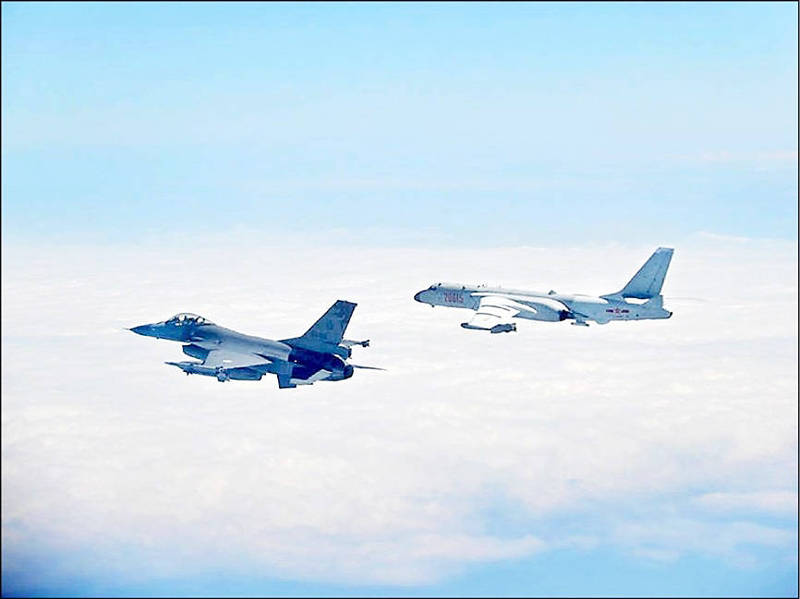 An air force F16, left, monitors a Chinese People's Liberation Army aircraft on Feb. 10 last year. Photo courtesy of the Ministry of National Defense
