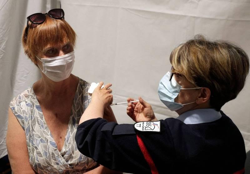 據《法新社》統計,全球已施近10億劑的疫苗。(法新社)