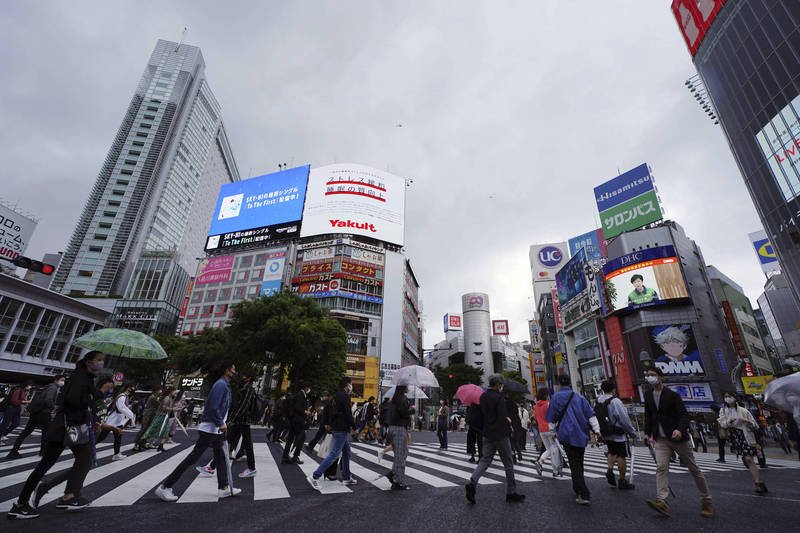 東京都今日疫情再度飆升,新增1027例,再度刷新1月28日以後最高單日記錄。圖為東京街景,示意圖。(美聯社)