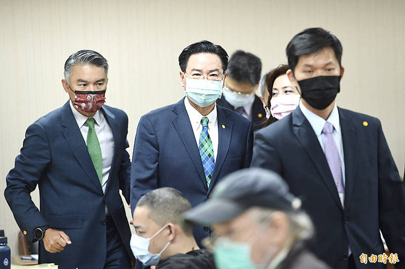 Minister of Foreign Affairs Joseph Wu, second left, is pictured at a meeting of the legislature's Foreign Affairs and National Defense Committee in Taipei yesterday. Photo: Peter Lo, Taipei Times
