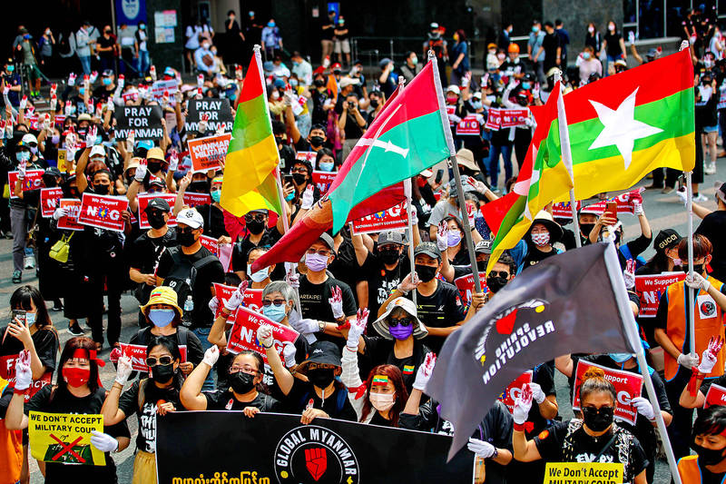 People in Taipei yesterday march against the military coup in Myanmar. Photo: Ritchie B. Tongo, EPA-EFE