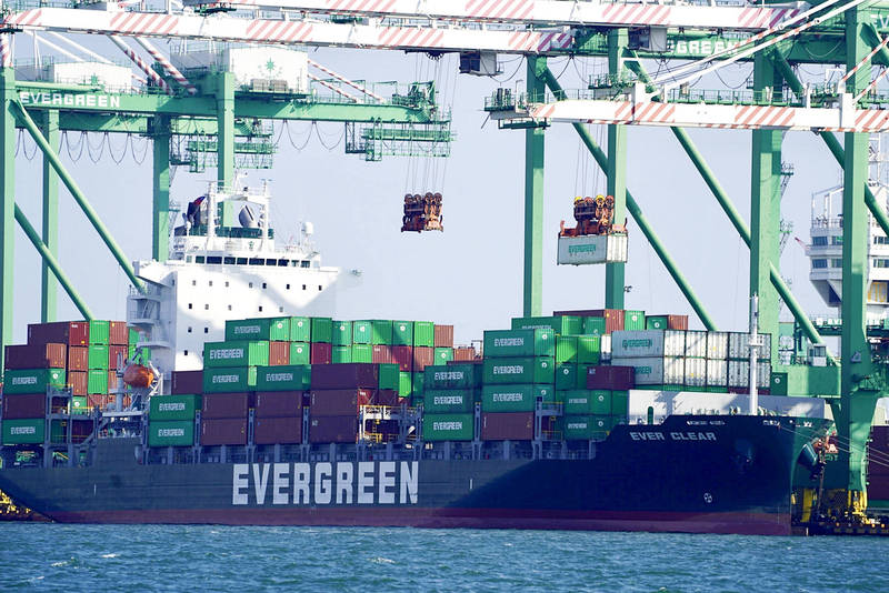 An Evergreen cargo ship is pictured at an unnamed port in an undated photograph. Photo: CNA