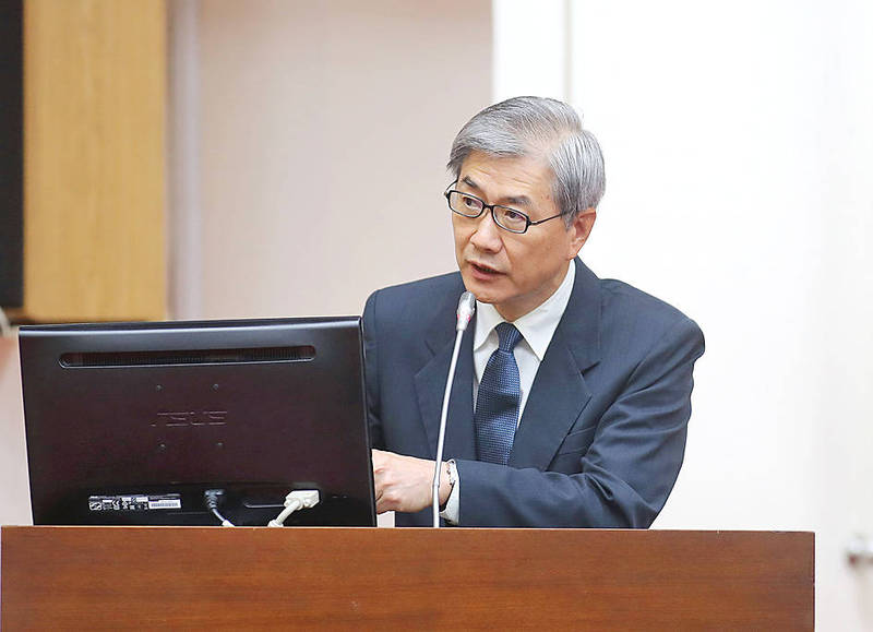 Financial Supervisory Commission Chairman Thomas Huang speaks at a meeting of the legislature's Finance Committee in Taipei yesterday. Photo: CNA