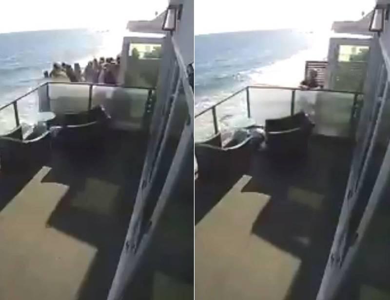 美國加州馬里布一間海岸別墅8日發生意外,當時有10幾人擠在小小的陽台上,陽台疑似不堪重負,突然崩塌。(翻攝MikeRogersTV@推特)