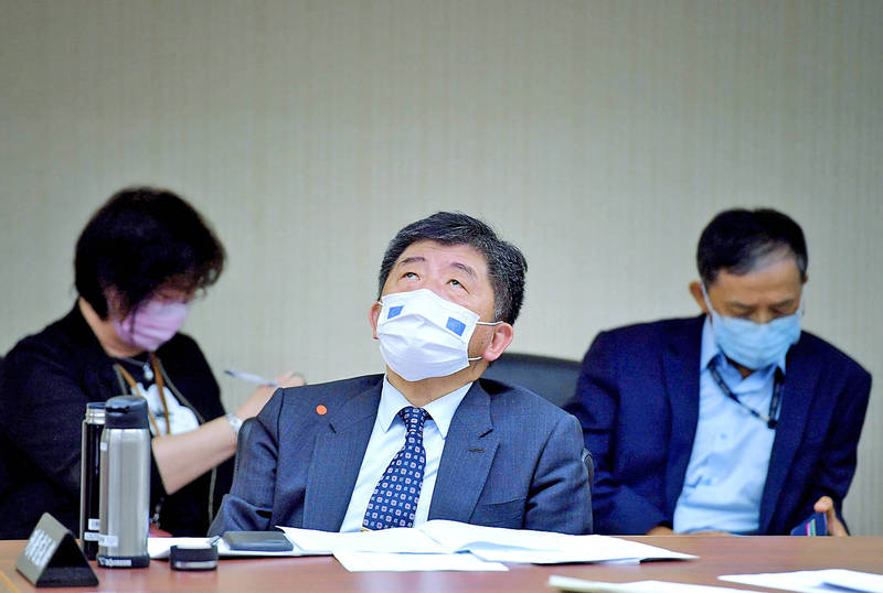 Minister of Health and Welfare Chen Shih-chung attends a meeting of the legislature's Social Welfare and Environmental Hygiene Committee in Taipei yesterday. Photo: CNA
