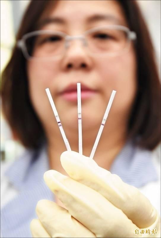 北市府在萬華設立4處快篩站,快篩試劑為中研院研發技轉給民間廠商。(資料照)