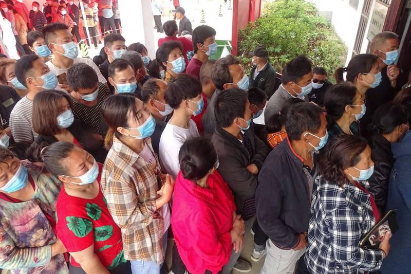 中國安徽及遼寧出現本土確診案例4天共14例,至今找不出感染源,多位官員遭官方問責。(美聯社)