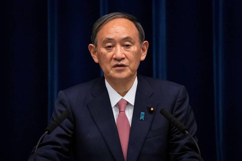日本首相菅義偉(見圖)與越南總理范明正舉行首次電話會談,就中國試圖改變東海和南海現狀表示強烈反對和嚴重關切。(路透)