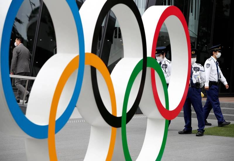 昨(21)日首相菅義偉與東京都知事小池百合子,針對舉辦東奧會與殘奧會的合作進行會談。(路透)