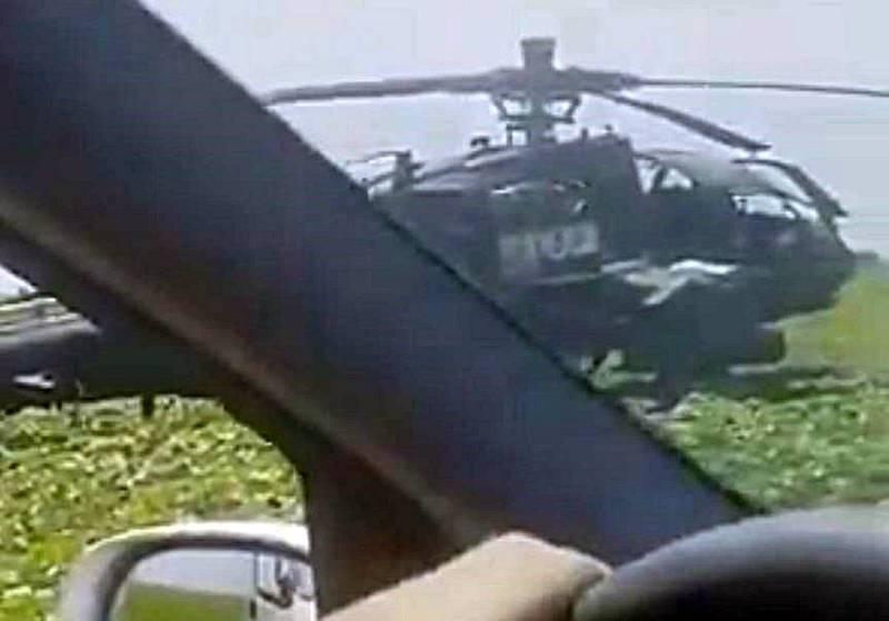 近日美军一架AH-64阿帕契攻击直升机安全地迫降于罗马尼亚的农田,机上人员并未受伤,有趣的是,一辆汽车经过该处,用英文询问机上人员「需要加油吗」,影片曝光,让不少网友莞尔一笑。(翻摄自推特)(photo:LTN)