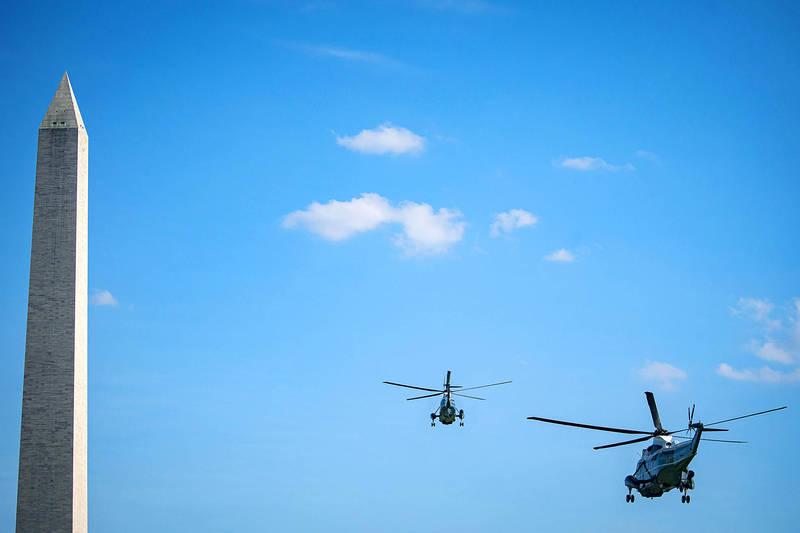 Marine One flies near the Washington Monument as it departs the Ellipse near the White House in Washington on Thursday. Photo: Bloomberg