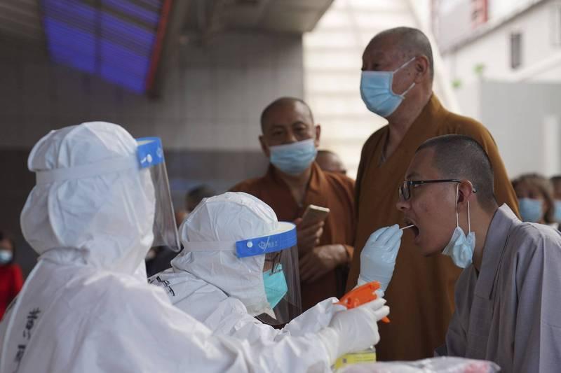 中國廣東的武漢肺炎疫情日益嚴峻,單日新增20起本土確診病例。(美聯社)