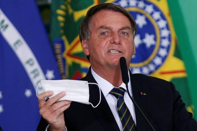 巴西擬針對已接種疫苗及曾染疫者解除口罩禁令。圖為巴西總統波索納洛。(路透)