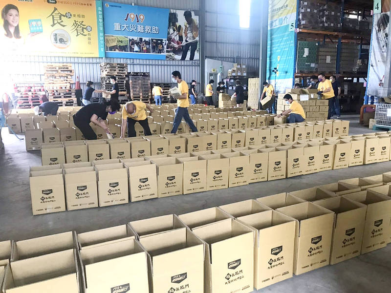 Workers and volunteers from the Chinese Christian Relief Association and allied charitable organizations prepare COVID-19 relief packages in a warehouse in an undated photograph. Photo courtesy of the Chinese Christian Relief Association