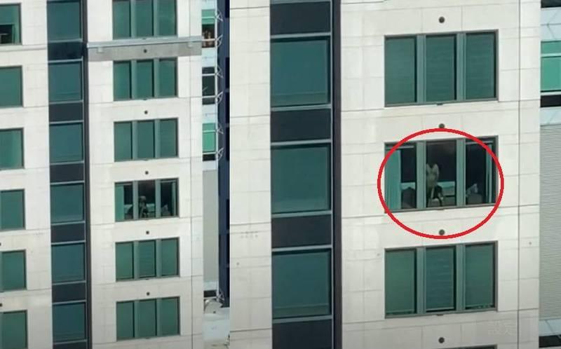 澳洲雪梨一對男女光天化日打開房間窗簾,大膽在落地窗前上演活春宮,整個過程都被對面商辦大樓的上班族給錄下。(圖取自YouTube)