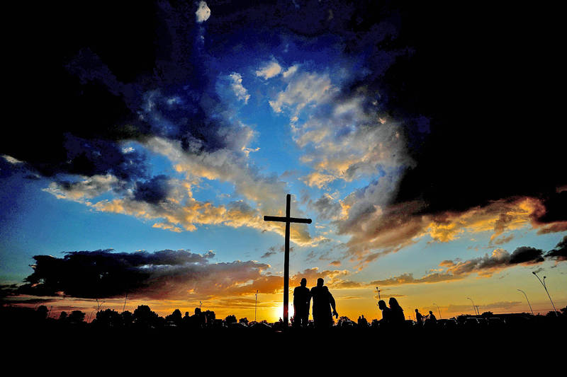 People watch the sunset at the Plaza del Cruzeiro during Mass in Brasilia on Saturday. Photo: EPA-EFE