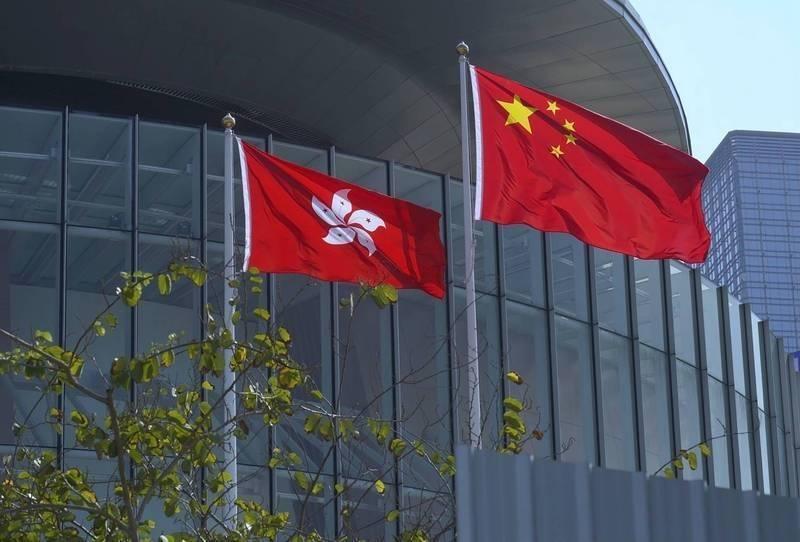 香港特區政府要求台灣駐港辦事處人員須簽署「一中承諾書」,我方人員拒簽昨日被迫返台。(美聯社資料照)