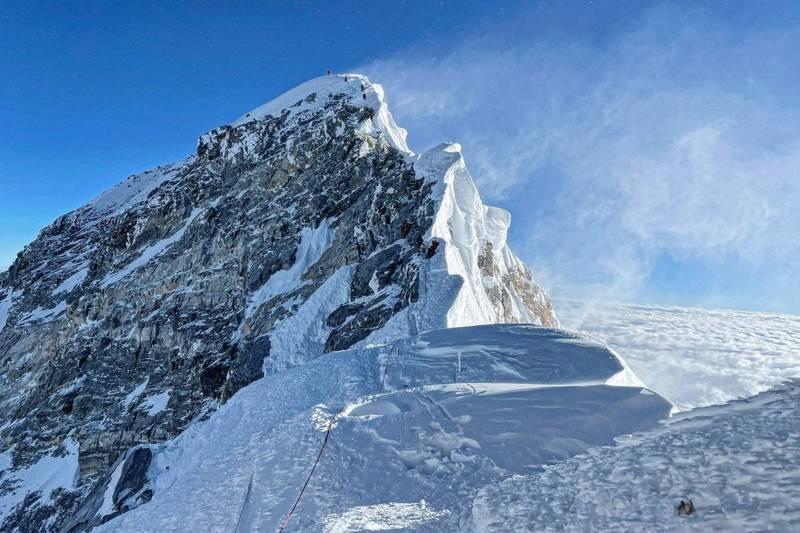 香港女性登山家曾燕紅表示,要回家似乎比登聖母峰還難。圖為聖母峰。(法新社)