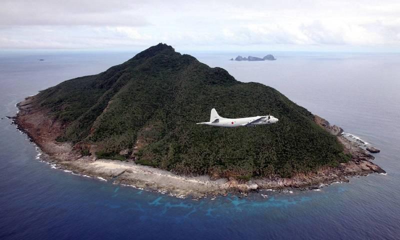 《金融時報》披露,美日一直為台海可能爆發衝突備戰。圖為日本海上自衛隊P-3C偵察機飛經釣魚台上空。(資料照,法新社)