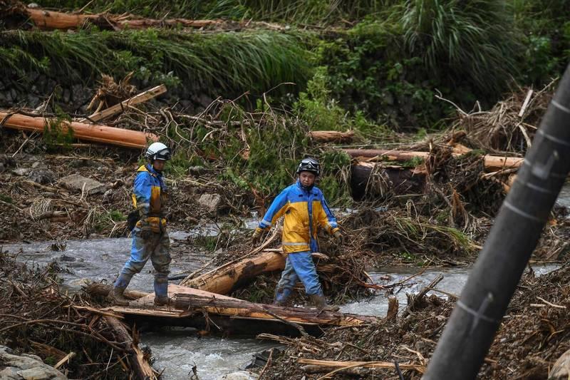 日本熊本縣和鹿兒島縣去(2020)年發生罕見恐怖暴雨,總共造成86人受害,也摧毀熊本縣的基礎建設。(法新社)