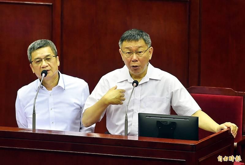 北捷董事長李文宗(左)與台北市長柯文哲。(資料照)