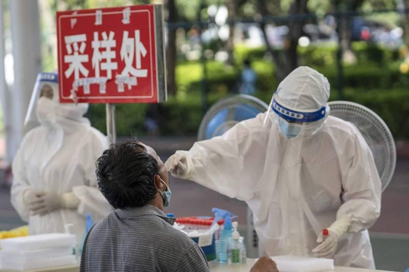 雲南疫情又升溫,昨雲南新增8例本土病例、1例本土無症狀感染者,還爆增41例境外移入確診。(法新社)