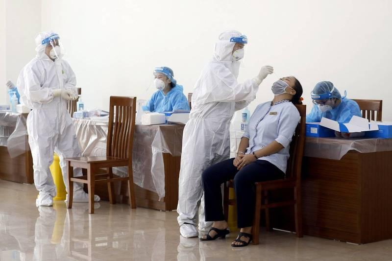 越南今天新增5343例武漢肺炎本土病例,其中重災區胡志明市封鎖近2週,疫情未明顯趨緩,當局可能祭出更嚴格的措施。(歐新社)