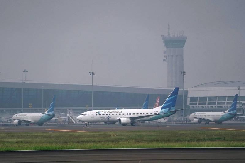 印尼台商包機於28日返台,日前突然生變,目前已成功改洽「印尼航空」包機,預計8月8日成行。(彭博)