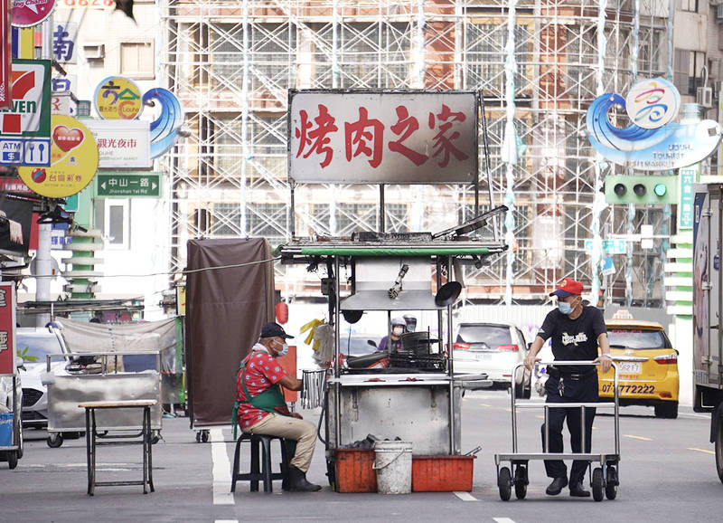 A food stall named BBQ House at Liouhe Night Market in Kaohsiung is pictured yesterday. Photo: CNA
