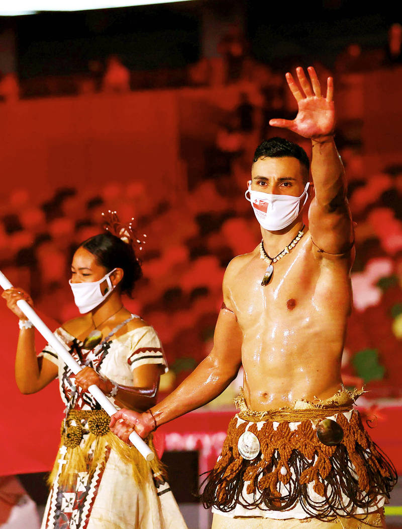 Tonga flag bearer Pita Taufatofua leads their contingent during the athletes' parade at the opening ceremony of the Tokyo Olympics on Friday. Photo: Reuters