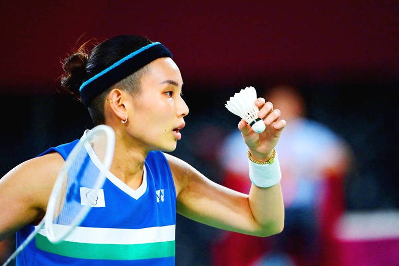 Taiwan's Tai Tzu-ying prepares to serve against Switzerland's Sabrina Jaquet during their women's singles badminton match at the Musashino Forest Sports Plaza at the Tokyo Olympics yesterday. Photo: AFP