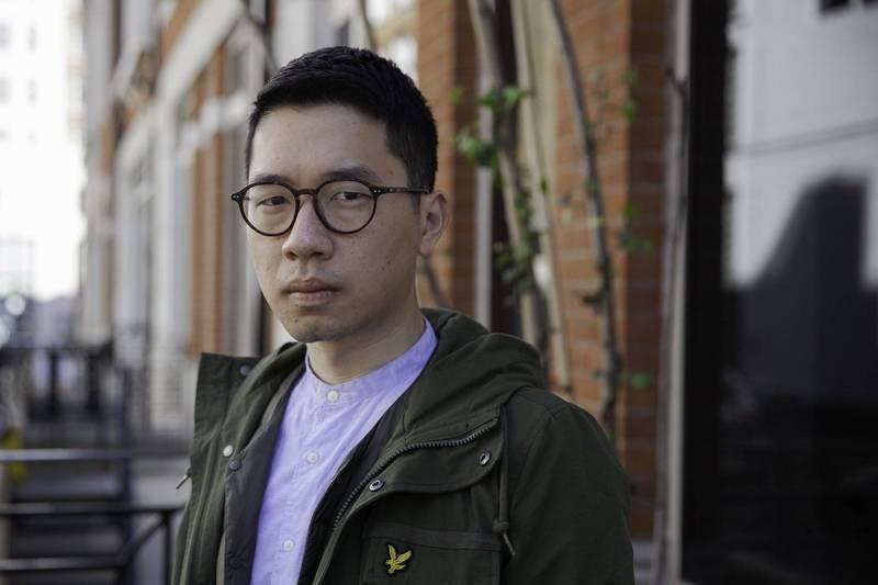羅冠聰指出,北京奧運時是港人中國身分認同的高峰,但十幾年來中共卻對香港不斷打壓。(彭博)