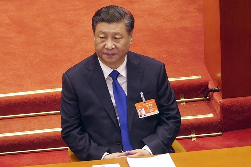 美國媒體分析,中國國家主席習近平不會在短期內武力侵台,但仍會使用軍事恫嚇、外交孤立、經濟威懾等「智統」、「逼統」行動。(美聯社資料照)