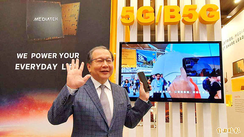 MediaTek Inc chief executive Rick Tsai holds a 5G smartphone at the company's booth at the Taipei International Convention Center on Dec. 8. Photo: Vanessa Cho, Taipei Times