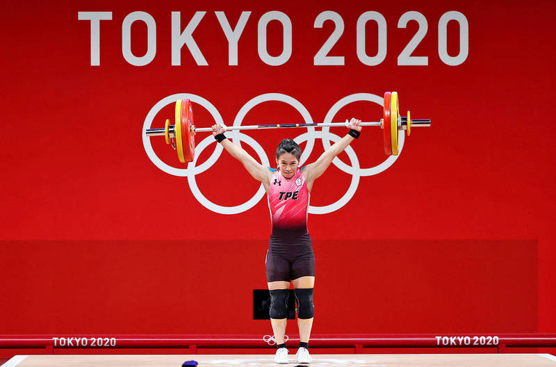 Taiwan's Kuo Hsing-chun competes in the Tokyo 2020 Olympics yesterday. She won gold in the women's under-59kg weight class. Photo: EPA-EFE